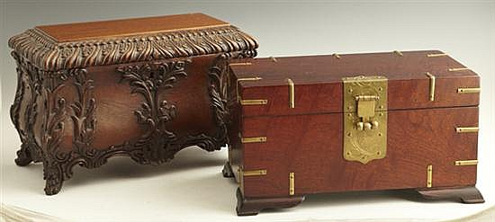 Two Contemporary Carved Mahogany Boxes, 20th c., one an oriental brass bound jewelry box with a lift out tray, the other an Indonesi...