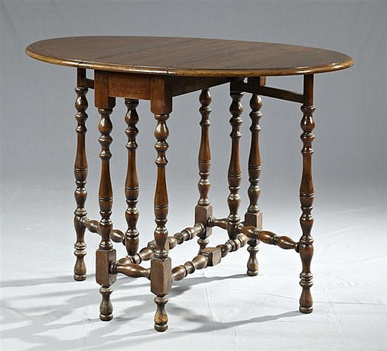 English Carved Mahogany Oval Gateleg Dropleaf Table, 20th c., on turned and block legs joined by turned and block stretchers, H.- 30...