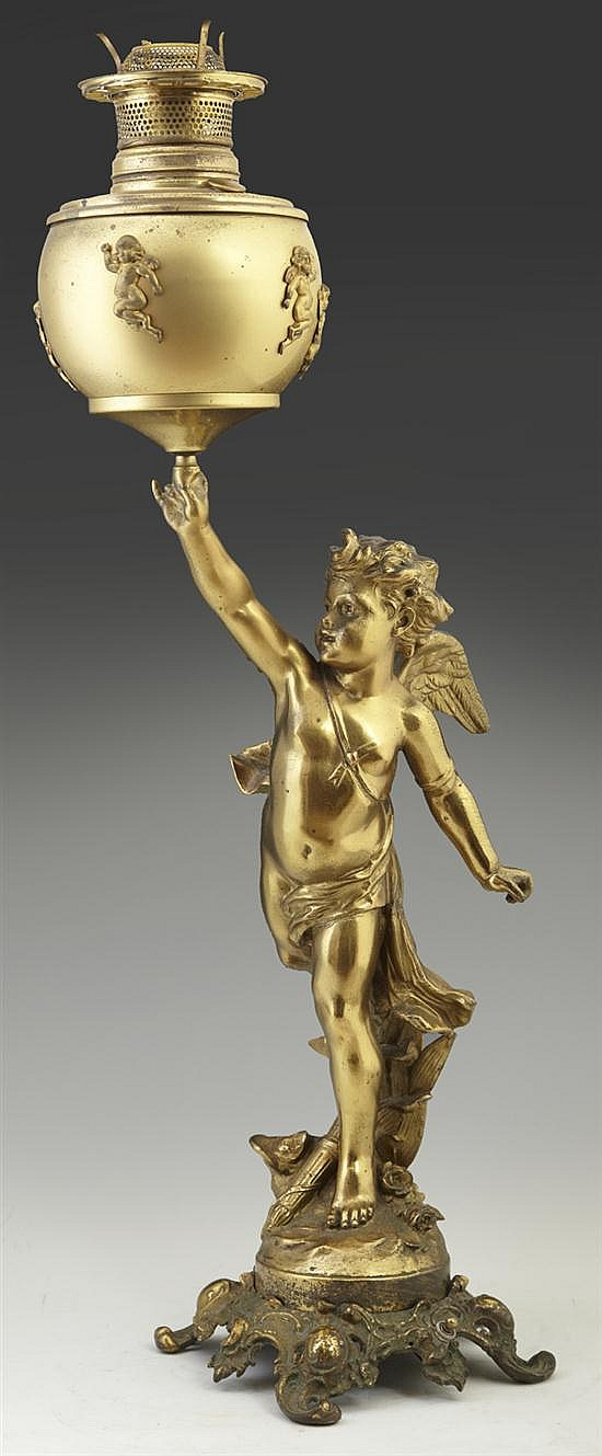 Victorian Brass Plated Cupid Banquet Lamp, c. 1890, the font with relief Cupid decorations upheld by a large figure of Cupid, standi...