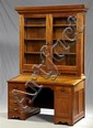 New Orleans Carved Mahogany and Cypress Bookcase Desk, c. 1890, the upper section with a stepped crown over dentillated molding abov...
