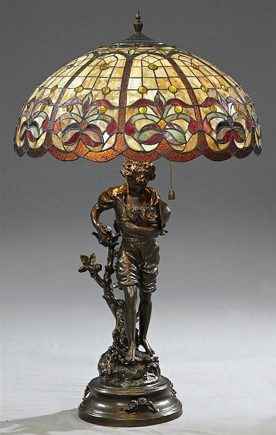 Art Nouveau Leaded Glass Patinated Spelter Figural Newel Post Lamp, late 20th c., the slag glass shade with floral decoration and ca...