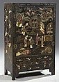 Diminutive Chinese Inlaid Black Laquer Cabinet, early 20th c., with gilt decoration and stone, bone and mother-of-pearl overlay depi...