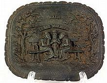 Cast iron dish with three rabbis on a bench