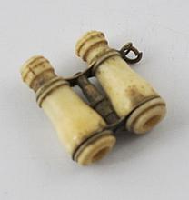Miniature brass and ivory binocular with mezuze text and Moses with the stone tablets