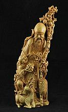 A Chinese finely carved ivory figure of Shou Lao with attendant and the symbols of longevity