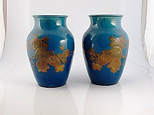 Pair of Japanese blue glaze porcelain vases with feeding rats