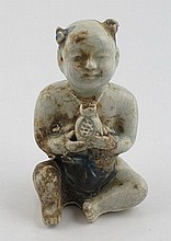 Chinese blue and white porcelain model of a child holding a pomegranate