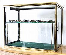 A BRASS AND PLATE GLASS DISPLAY CABINET^ with one