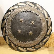 AN EARLY INDIAN HIDE SHIELD^ re-used in the 19th/2