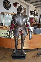 A FULL SUIT OF COMPOSITE ARMOUR 16TH CENTURY AND L