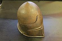 A 16TH CENTURY STYLE JOUSTING HELMET with single e
