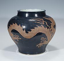 A BLUE-GROUN BROWN GLAZED 'DRAGON' JAR