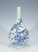 A BLUE AND WHITE 'BIRD AND FOWER' JAR