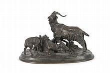 Pierre-Jules MENE  (1810-1879)  Famille de chèvres.  Bronze à patine brune.  Signé.  H. : 14 cm. L. : 22 cm. P. : 12,5 cm.