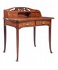 CAMILLE GAUTHIER (1870-1963) & PAU L POINSIGNON attribué à Elégant bureau de dame en acajou et bois exotique de forme violonée. Il ouvre à deux tiroirs en façade garnis de poignées naturalistes en bronze et en partie arrière deux petits tiroirs et un