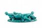 Clément Massier (1845-1917)  Jardinière modèle « Bateau » en céramique bleue  pâle à décor de quatre putti tirant une barque.  Signée et située Golfe Juan. L. : 44 cm.  Bibliographie : Modèle répertorié page 118 dans  Massier, Éd. RMN 2000.