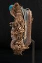 Masque Guerrier We, Niamba, Côte d'Ivoire. Bois, fibres végétales, tissus, éléments métalliques. H. : 32 cm. Masque dit aussi de la forêt, ayant conservé ses parures de fibres et de tissu.