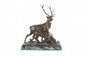 Charles PAILLET (1871-1937)  Cerf et sa biche.  Groupe en bronze à patine mordorée.  Signé.  H. : 57 cm. L. : 53 cm. P. : 18 cm.    Deer and Doe. Group bronze with golden brown  patina. (Signed). 22,5 in. High, 21 in. Wide, 7 in. Depth.