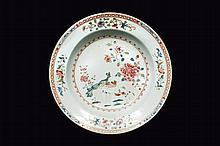 Assiette en porcelaine famille rose