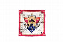 HERMES   Carré en soie damassée et imprimée, bordure rouge,    titré « Vue du carrosse de la galère la Réale ».   Etat d'usage (petites salissures).