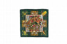 HERMES Paris   Carré en soie imprimée fond vert, titré « Le tarot »,    dessiné par Annie Faivre.   Etat d'usage.