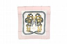 HERMES   Carré en soie imprimée, bordure rose pâle, titré    « Brides de Gala », dessiné par Hugo Grygkar.   90 x 90 cm.   Etat d'usage.
