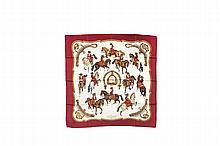 HERMES   Carré en soie imprimée, bordure rouge bordeaux,    titré « Reprise ».   Etat d'usage (salissures).