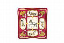 HERMES   Carré en soie imprimée, titré « Grand Apparat »,   dessiné par Jacques Eudel.   Etat d'usage (salissures).