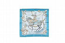HERMES   Carré en soie imprimé turquoise à décor de cavalier    « les feux d'artifice ».   Bon état.