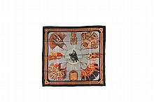 HERMES Paris   Carré en soie imprimée, bordure noire, titré    « Cuirs du désert », signé F de la Perrière.   Bon état.