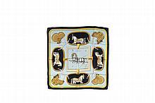 HERMES Paris   Carré en soie imprimée dans des tons de bleu,   titré « Grand apparat ».   Etat d'usage (salissures).