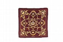 HERMES   Carré en soie imprimée, rouge bordeaux à décor    de couronnes dorées.   Etat d'usage.