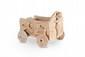 EXCEPTIONNEL CHARIOT SYRO-HITTITE Modèle de chariot en terre cuite de forme quadrangulaire muni de quatre roues mobiles. Décor gravé et appliqué : une idole féminine à bec d'oiseau appliquée sur le devant, deux cervidés affrontés appliqués sur chaque