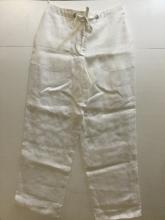 HERMES PARIS  Pantalon ample en lin blanc. Fermeture à glissière, bouton,