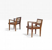PIERRE JEANNERET (1896-1967) Paire de fauteuils. Moelle de rotin, teck.