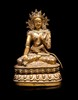 Statuette de bodhisattva en bronze doré  Art sino-tibétain.  La divinité représentée assise en padmasana sur un socle  lotiforme, parée d'un diadème et de bijoux, la main gauche  relevée, le visage souriant. H. : 23 cm.