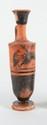 LÉCYTHE  En céramique à figures noires décoré de Dionysos conduisant un char.  Art grec. VIè s. av. J.-C.  H. : 19 cm.