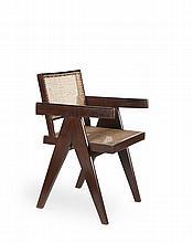 PIERRE JEANERET (1896-1967) Paire de fauteuils dit Office cane chair. Teck, moelle de rotin. 79 x 50 x x 53.5 cm. Circa 1955. Provenance : Chandigarh, Inde. Bibliographie : - Revue Architectural Digest, France, septembre-octobre 2010, modèle