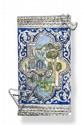 Carreau au paysage Carreau de revêtement décoré en polychromie d'un paysage au minaret. Iran, XIXème siècle. 60 x 35 cm. Egrenures.