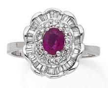 Bague en or gris centrée d'un rubis ovale dans un double entourage de diamants taillés en brillant et en baguette.