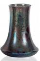 Delphin MASSIER (1836-1907) Vase de forme cylindrique à base aplatie en céramique irisée à décor floral dans les tons de vert et violet. Signé. H. : 18 cm.