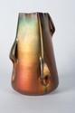 Jérôme MASSIER (1850-1926) Vase de forme conique à pans coupés à anses asymétriques en céramique irisée dans des tons flamboyants. Signé et situé à Vallauris. H. : 21 cm.