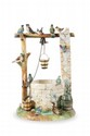 DELPHIN MASSIER (1836-1907) Le puits aux oiseaux. Groupe en céramique polychrome. Grand modèle. Signé. H. : 66 cm.