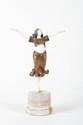 Claire Jeanne Roberte Colinet (1880-1950) Danseuse orientale. Sujet en bronze polychrome et ivoire sur socle octogonale en marbre beige veiné. Ornementation de pastilles émaillées sur la robe et la coiffure. Signé. H. : 34 cm.