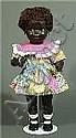 Puppenmädchen mit dunkler Hautfarbe.