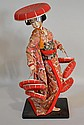 JAPANESE GEISHA DOLL. doll with rectangular base and silk kimono. Size; 17 1/2''H, 7'' x 6'' base. Condition: all dolls sold as is.
