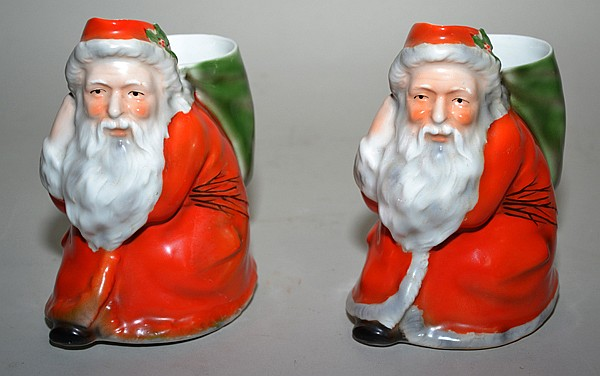 ROYAL BAYREUTH SANTA CLAUS WATER PITCHER 2 PIECES. Two Royal Bayreuth porcelain Santa Claus form water pitchers, one with white and grey fur trimmed robe, one with all red robe. Marked; blue Royal Bayreuth Bavaria mark. Size; 6 1/4''H. Condition: age
