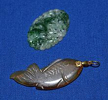 14K. GOLD AND JADE JEWELRY LOT 2 PIECES  Includes: Brown Jade fish pendant with 14K. clasp. 2''L.  Green and white pierced jade medallion. 1 1/2''L.  Condition all jewelry sold as is.
