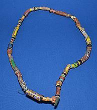 AFRICAN TRADE BEAD NECKLACE  African millefiore glass trade bead necklace.  60 total beads. Sizes 1/4 - 2''L. Necklace 30''L.  Condition all jewelry sold as is.