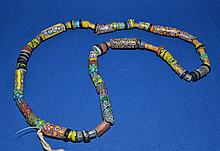 AFRICAN TRADE BEAD NECKLACE  African millefiore glass trade bead necklace. 75 beads.  Size range 1/8 - 1 1/2''L.  Necklace 27''L. Condition all jewelry sold as is.